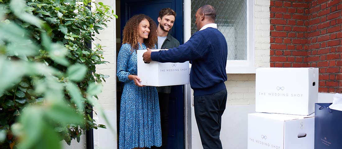 Newly married couple having their wedding gifts delivered