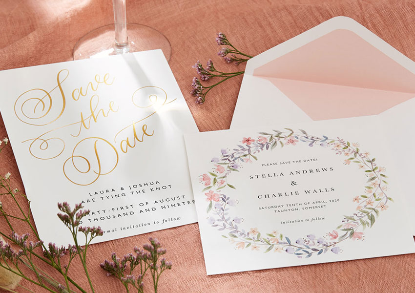 Papier save the date wedding stationery with multi-coloured flowers