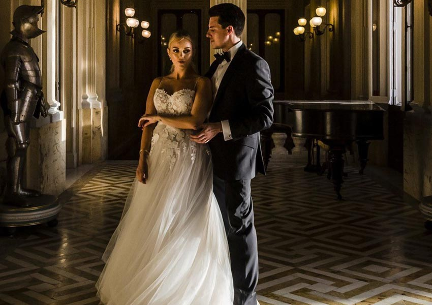 Stunning castle wedding photograph of a real wedding shop couple