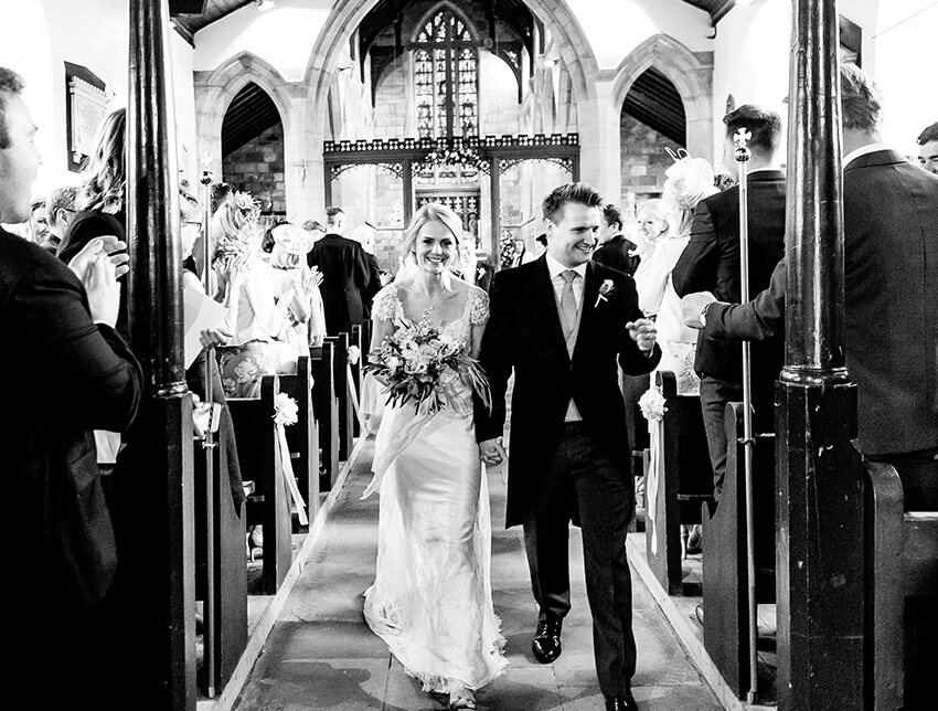 Couple Walking Down Aisle Wedding Gown